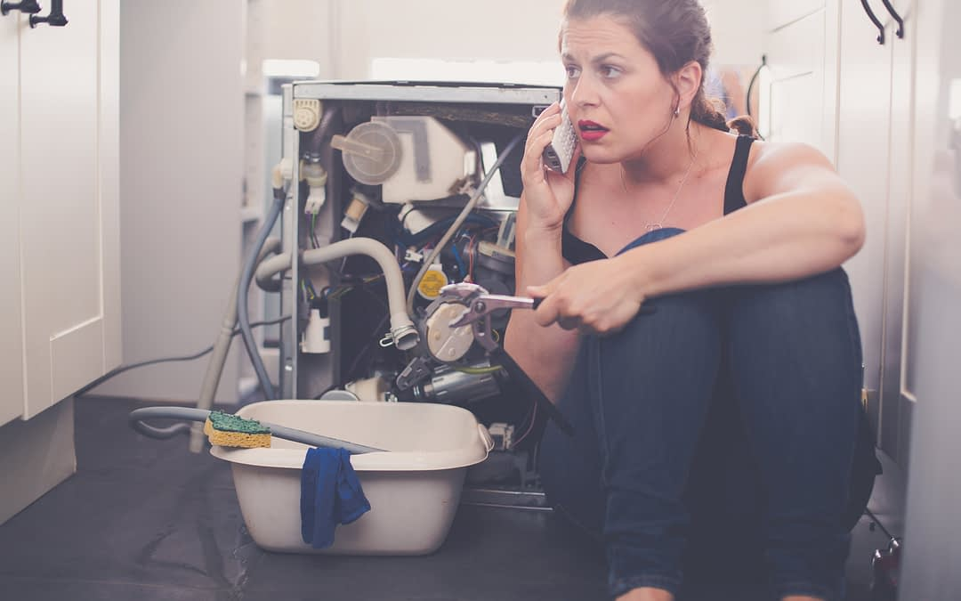 Lady on phone with plumber